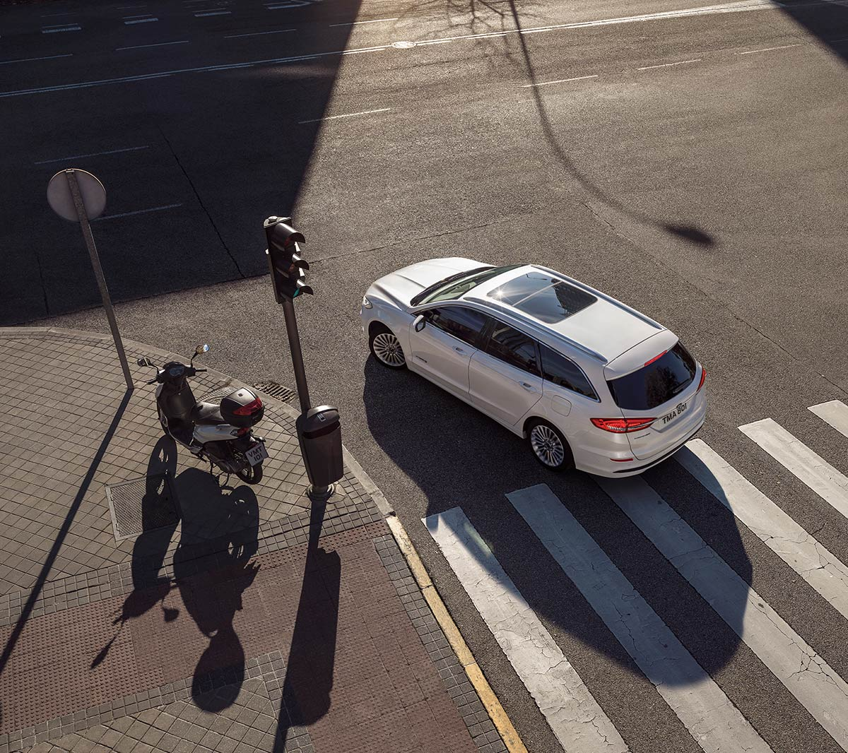 White Ford Mondeo on the crossroad from bird's view