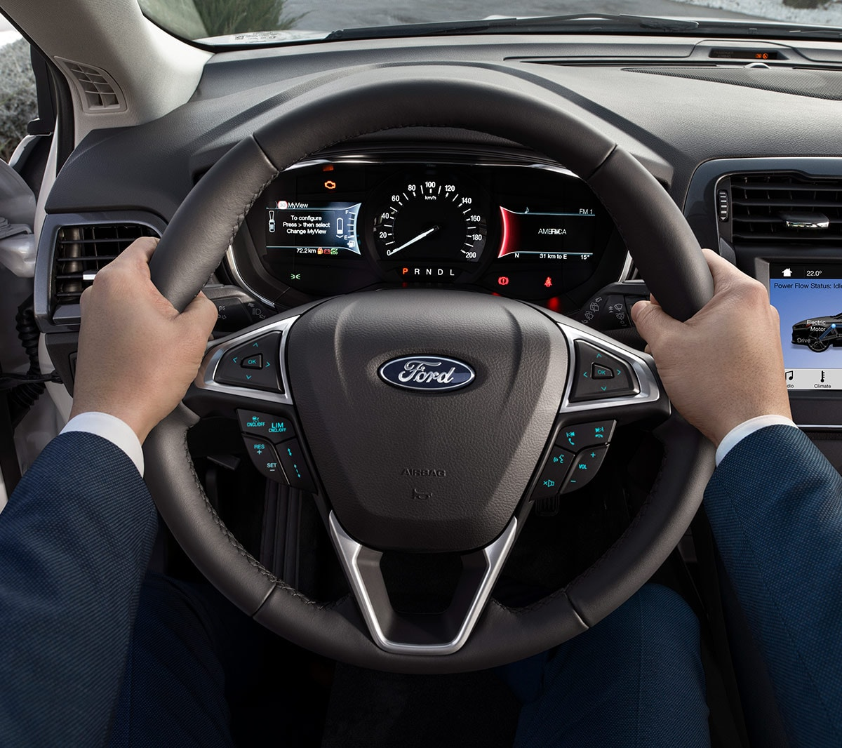 Ford Mondeo interior close up of hands with steering wheel and dashboard